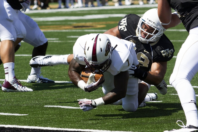 Sep 14, 2013; Winston-Salem, NC, USA; Wake Forest Demon Deacons defensive end Zach Thompson (98) stops Louisiana Monroe Warhawks running back Jyruss Edwards (7) short of the goal line during the first quarter at BB&T Field. Mandatory Credit: Jeremy Brevard-USA TODAY Sports