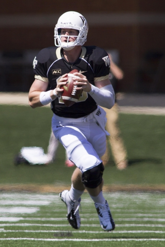 Sep 14, 2013; Winston-Salem, NC, USA; Wake Forest Demon Deacons quarterback Tanner Price (10) looks to pass the ball during the second quarter against the Louisiana Monroe Warhawks at BB&T Field. Mandatory Credit: Jeremy Brevard-USA TODAY Sports