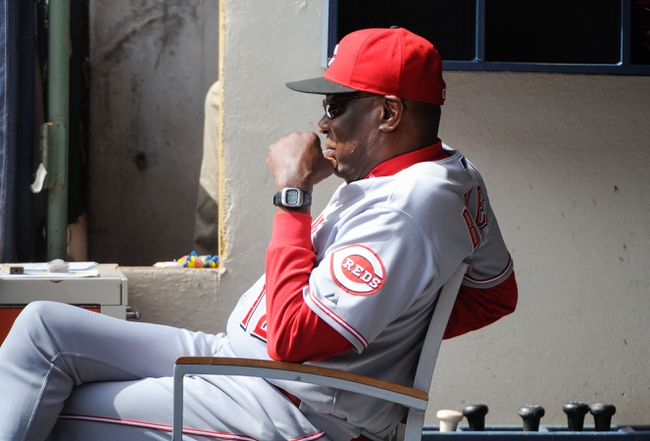 Sep 14, 2013; Milwaukee, WI, USA;  Cincinnati Reds manager Dusty Baker watches game against the Milwaukee Brewers from the dugout in the third inning at Miller Park. Mandatory Credit: Benny Sieu-USA TODAY Sports