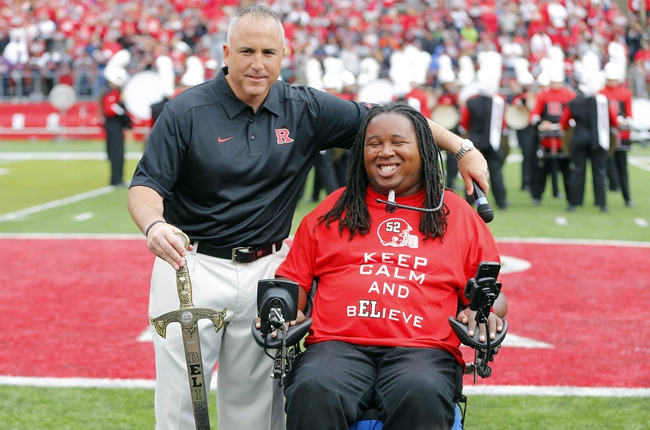 Sep 14, 2013; Piscataway, NJ, USA;  Rutgers Scarlet Knights former player Eric LeGrand (right) poses with head coach Kyle Flood during halftime of a game against the Eastern Michigan Eagles for his jersey number retirement ceremony at High Points Solutions Stadium. Mandatory Credit: Jim O'Connor-USA TODAY Sports