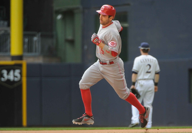 Sep 14, 2013; Milwaukee, WI, USA;  Cincinnati Reds first baseman Joey Votto runs the bases after hitting a 2-run homer in the sixth inning against the Milwaukee Brewers at Miller Park. Mandatory Credit: Benny Sieu-USA TODAY Sports