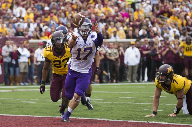 Sep 14, 2013; Minneapolis, MN, USA; Western Illinois Leathernecks linebacker Kevin Kintzel (17) recovers a fumble in the third quarter against the Minnesota Golden Gophers at TCF Bank Stadium. The Gophers won 29-12. Mandatory Credit: Jesse Johnson-USA TODAY Sports