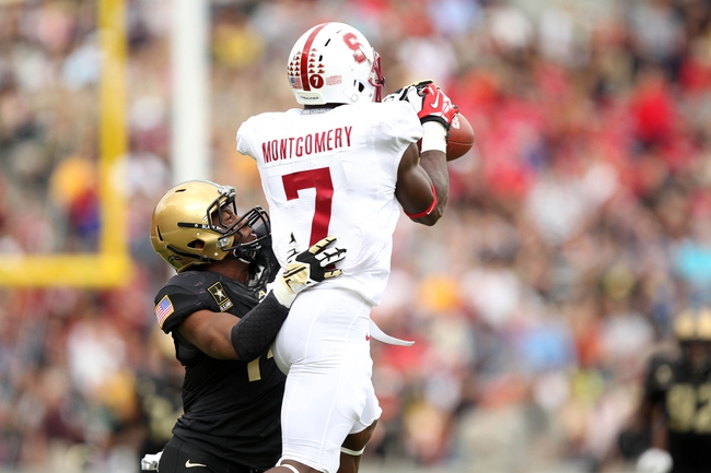 Sep 14, 2013; West Point, NY, USA; Stanford Cardinal wide receiver Ty Montgomery (7) makes a catch over Army Black Knights defensive back Chris Carnegie (14) at Michie Stadium. Mandatory Credit: Danny Wild-USA TODAY Sports