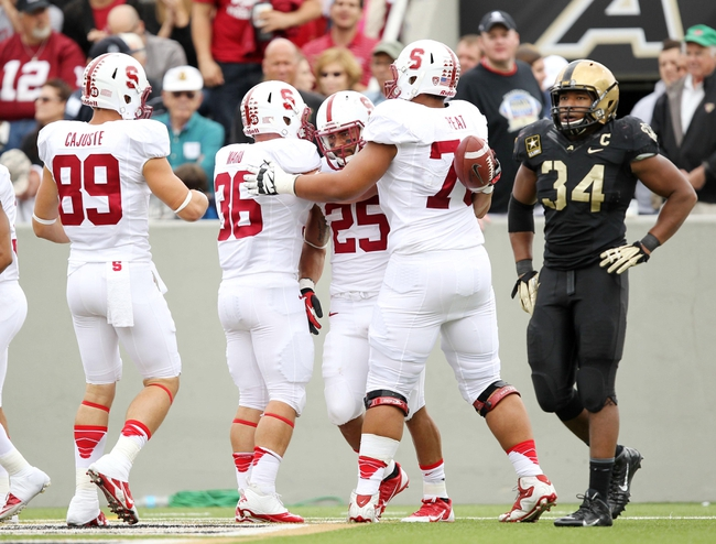 Sep 14, 2013; West Point, NY, USA; Stanford Cardinal running back Tyler Gaffney (25) celebrates with teammates after a touchdown against the Army Black Knights during the second half at Michie Stadium. Mandatory Credit: Danny Wild-USA TODAY Sports