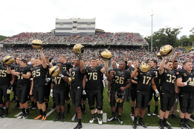 Sep 14, 2013; West Point, NY, USA; Army Black Knights players stand during the West Point alma mater after losing to Stanford 34-20 at Michie Stadium. Mandatory Credit: Danny Wild-USA TODAY Sports