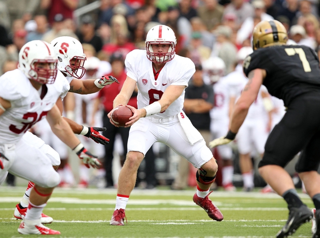 Sep 14, 2013; West Point, NY, USA; Stanford Cardinal quarterback Kevin Hogan (8) hands off during the second half against the Army Black Knights at Michie Stadium. Mandatory Credit: Danny Wild-USA TODAY Sports