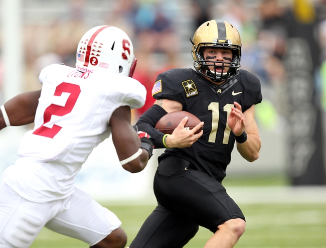 Sep 14, 2013; West Point, NY, USA; Army Black Knights quarterback A.J. Schurr (11) runs during the second half against the Stanford Cardinal at Michie Stadium. Mandatory Credit: Danny Wild-USA TODAY Sports