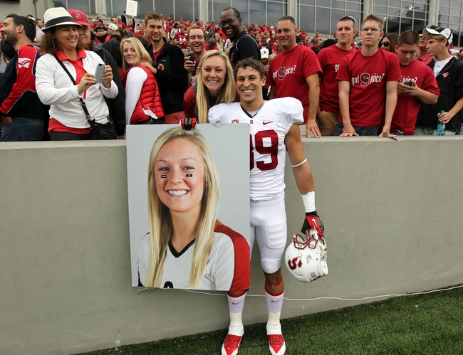 Sep 14, 2013; West Point, NY, USA; Stanford Cardinal wide receiver Devon Cajuste (89) poses with his girlfriend and a poster of his girlfriend made by West Point cadets after the game against the Army Black Knights at Michie Stadium. Mandatory Credit: Danny Wild-USA TODAY Sports
