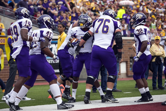 Sep 14, 2013; Minneapolis, MN, USA; Western Illinois Leathernecks wide receiver Lance Lenoir Jr. (7) celebrates with teammates after making a touchdown catch in the third quarter against the Minnesota Golden Gophers at TCF Bank Stadium. The Gophers won 29-12. Mandatory Credit: Jesse Johnson-USA TODAY Sports