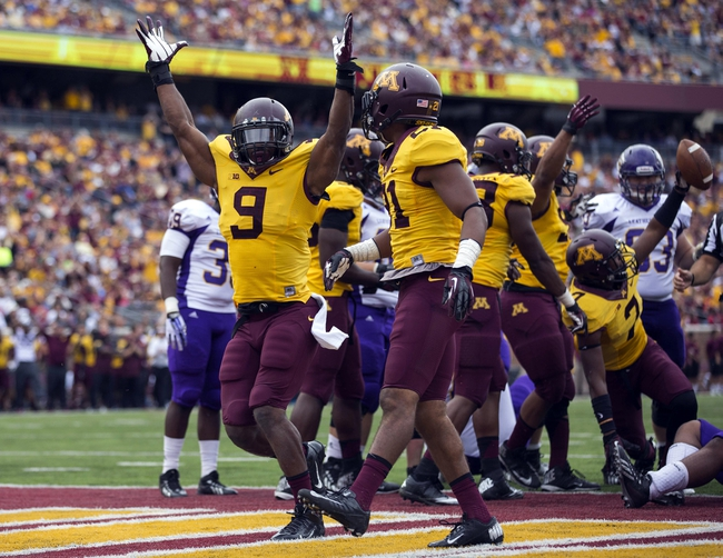Sep 14, 2013; Minneapolis, MN, USA; Minnesota Golden Gophers linebacker James Manuel (9) and defensive back Brock Vereen (21) celebrate after making a stop in the third quarter against the Western Illinois Leathernecks at TCF Bank Stadium. The Gophers won 29-12. Mandatory Credit: Jesse Johnson-USA TODAY Sports