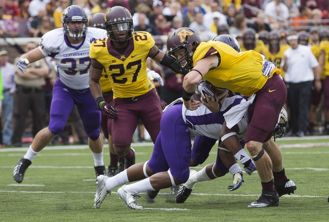 Sep 14, 2013; Minneapolis, MN, USA; Minnesota Golden Gophers quarterback Mitch Leidner (7) runs with the ball and gets tackled short of a touchdown by Western Illinois Leathernecks defensive back Jonathan Rollins (4) in the third quarter at TCF Bank Stadium. The Gophers won 29-12. Mandatory Credit: Jesse Johnson-USA TODAY Sports