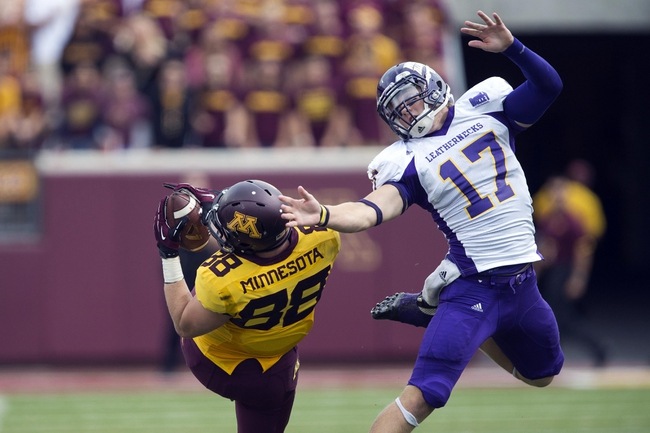 Sep 14, 2013; Minneapolis, MN, USA; Minnesota Golden Gophers tight end Maxx Williams (88) catches the ball past Western Illinois Leathernecks linebacker Kevin Kintzel (17) in the fourth quarter at TCF Bank Stadium. The Gophers won 29-12. Mandatory Credit: Jesse Johnson-USA TODAY Sports