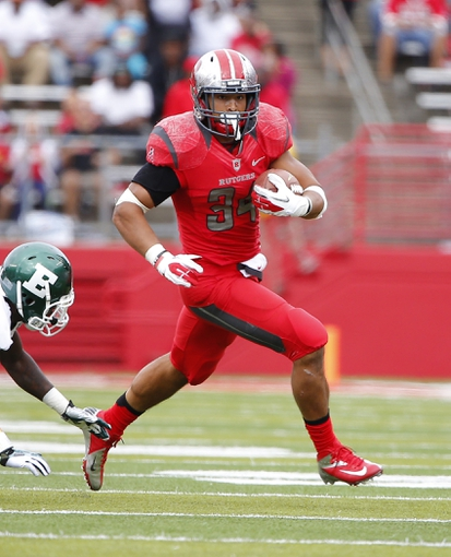 Sep 14, 2013; Piscataway, NJ, USA;  Rutgers Scarlet Knights running back Paul James (34) runs for a touchdown in the third quarter against the Eastern Michigan Eagles at High Points Solutions Stadium. Rutgers won 28-10. Mandatory Credit: Jim O'Connor-USA TODAY Sports