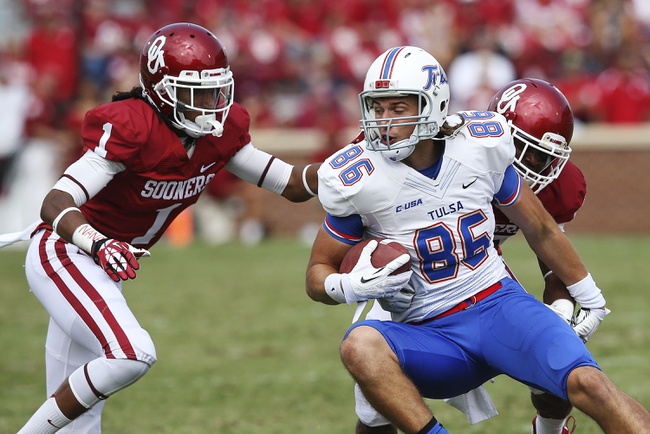 Sep 14, 2013; Norman, OK, USA; Tulsa Golden Hurricane wide receiver Zach Epps (86) is tackled by Oklahoma Sooners defensive back L.J. Moore (1) during the game at Gaylord Family - Oklahoma Memorial Stadium. Mandatory Credit: Kevin Jairaj-USA TODAY Sports