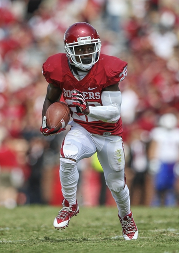 Sep 14, 2013; Norman, OK, USA; Oklahoma Sooners running back Roy Finch (22) runs with the ball during the game against the Tulsa Golden Hurricane at Gaylord Family - Oklahoma Memorial Stadium. Mandatory Credit: Kevin Jairaj-USA TODAY Sports