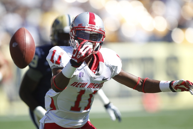 Sep 14, 2013; Pittsburgh, PA, USA; New Mexico Lobos wide receiver Ridge Jones (11) loses the ball on a pitch out against the Pittsburgh Panthers during the third quarter at Heinz Field. The Pittsburgh Panthers won 49-27. Mandatory Credit: Charles LeClaire-USA TODAY Sports