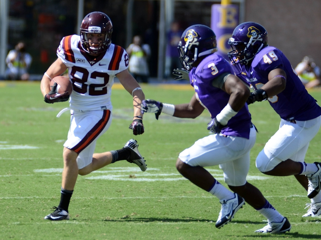 Sep 14, 2013; Greenville, NC, USA; Virginia Tech Hokies receiver Willie Byrn (82) is pursued by East Carolina Pirates defenders Adonis Armstrong (3) and Ty Holmes (49) after a catch during the second half at Dowdy-Ficklen Stadium.  Virginia Tech won 15-10. Mandatory Credit: Rob Kinnan-USA TODAY Sports