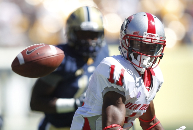 Sep 14, 2013; Pittsburgh, PA, USA; New Mexico Lobos wide receiver Ridge Jones (11) loses the ball on a pitch oout against the Pittsburgh Panthers during the third quarter at Heinz Field. The Pittsburgh Panthers won 49-27. Mandatory Credit: Charles LeClaire-USA TODAY Sports