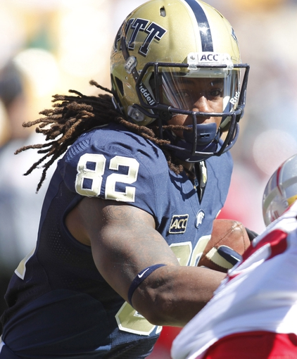 Sep 14, 2013; Pittsburgh, PA, USA; Pittsburgh Panthers tight end Manasseh Garner (82) runs after a pass reception against the New Mexico Lobos during the third quarter at Heinz Field. The Pittsburgh Panthers won 49-27. Mandatory Credit: Charles LeClaire-USA TODAY Sports
