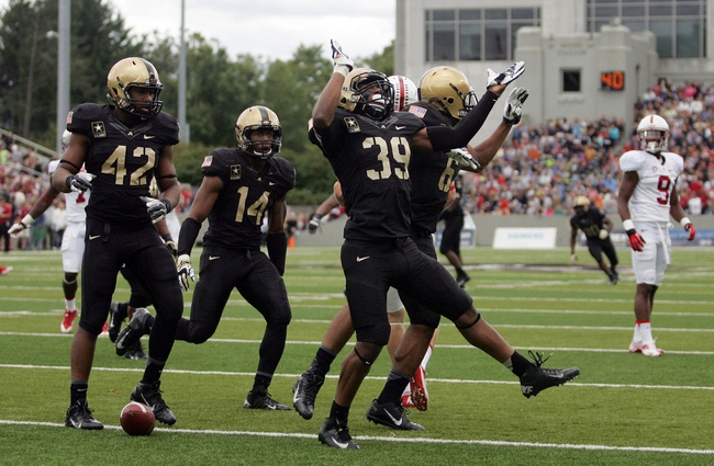 Sep 14, 2013; West Point, NY, USA; Army Black Knights defensive back Josh Jenkins (39) celebrates after intercepting a pass throw by Stanford Cardinal quarterback Kevin Hogan (not pictured) during the second half at Michie Stadium. Mandatory Credit: Danny Wild-USA TODAY Sports