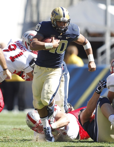 Sep 14, 2013; Pittsburgh, PA, USA; Pittsburgh Panthers running back James Conner (40) carries the ball against the New Mexico Lobos during the third quarter at Heinz Field. The Pittsburgh Panthers won 49-27. Mandatory Credit: Charles LeClaire-USA TODAY Sports