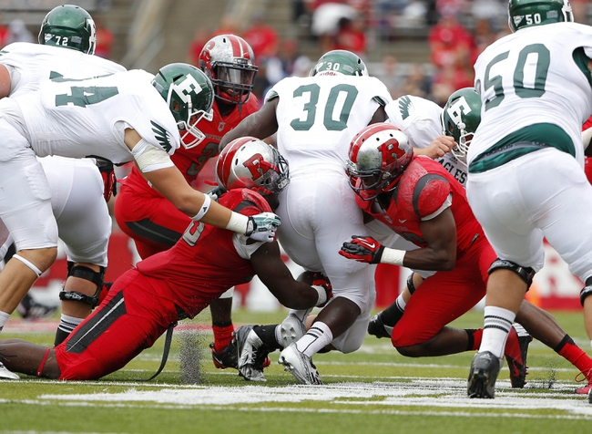 Sep 14, 2013; Piscataway, NJ, USA;  Rutgers Scarlet Knights defensive lineman Jamil Merrell (left) and defensive back Davon Jacobs (right) wrap up Eastern Michigan Eagles running back Bronson Hill (30) during the second half at High Points Solutions Stadium. Rutgers won 28-10. Mandatory Credit: Jim O'Connor-USA TODAY Sports