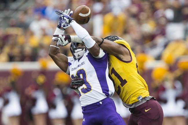 Sep 14, 2013; Minneapolis, MN, USA; Minnesota Golden Gophers defensive back Brock Vereen (21) defends the pass against Western Illinois Leathernecks wide receiver Hi-C Scott (19) at TCF Bank Stadium. The Gophers won 29-12. Mandatory Credit: Jesse Johnson-USA TODAY Sports