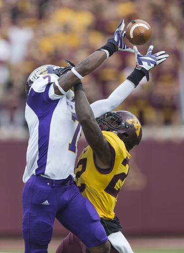 Sep 14, 2013; Minneapolis, MN, USA; Western Illinois Leathernecks wide receiver Lance Lenior Jr. (17) catches a pass over Minnesota Golden Gophers defensive back Brock Vereen (21) in the fourth quarter at TCF Bank Stadium. The Gophers won 29-12. Mandatory Credit: Jesse Johnson-USA TODAY Sports