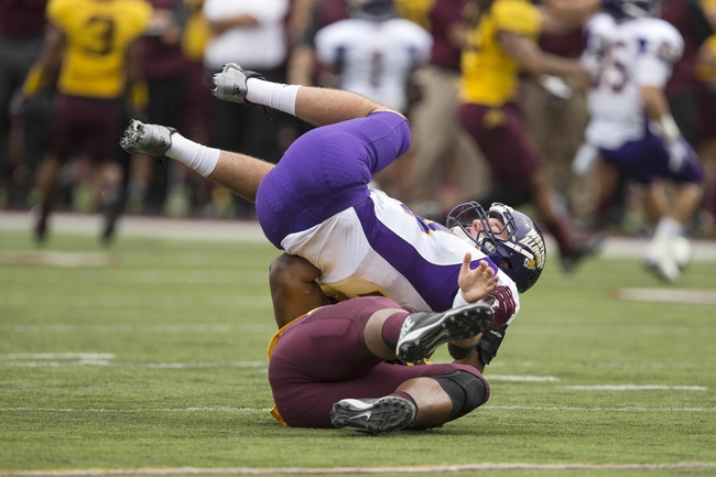 Sep 14, 2013; Minneapolis, MN, USA; Western Illinois Leathernecks quarterback Trenton Norvell (14) gets sacked by Minnesota Golden Gophers defensive lineman Ra'Shede Hageman (99) in the fourth quarter at TCF Bank Stadium. The Gophers won 29-12. Mandatory Credit: Jesse Johnson-USA TODAY Sports