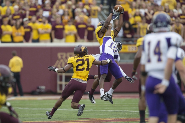 Sep 14, 2013; Minneapolis, MN, USA; Minnesota Golden Gophers defensive back Antonio Johnson (11) and defensive back Brock Vereen (21) defend the ball from Western Illinois Leathernecks wide receiver Hi-C Scott (19) in the fourth quarter at TCF Bank Stadium. The Gophers won 29-12. Mandatory Credit: Jesse Johnson-USA TODAY Sports