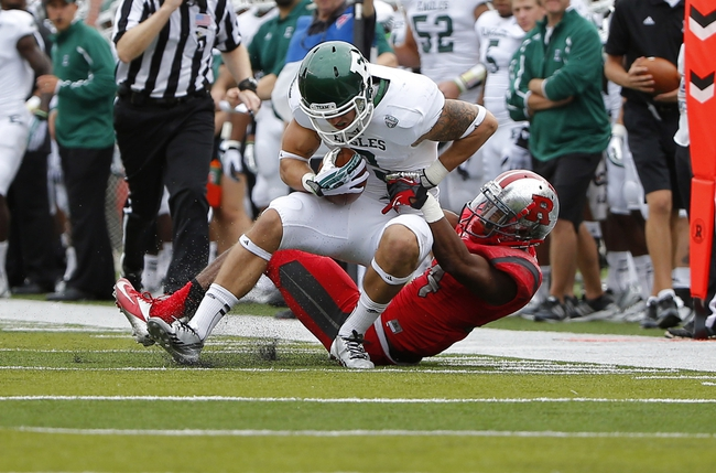 Sep 14, 2013; Piscataway, NJ, USA;  Rutgers Scarlet Knights defensive back Lew Toler (24) brings down Eastern Michigan Eagles wide receiver Dustin Creel (3) after reception during the second half at High Points Solutions Stadium. Rutgers Scarlet Knights defeat Eastern Michigan Eagles 28-10. Mandatory Credit: Jim O'Connor-USA TODAY Sports