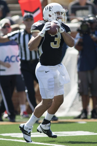 Sep 14, 2013; Winston-Salem, NC, USA; Wake Forest Demon Deacons wide receiver Michael Campanaro (3) catches a pass during the third quarter against the Louisiana Monroe Warhawks at BB&T Field. Louisiana Monroe Warhawks defeated the Wake Forest Demon Deacons 21-19. Mandatory Credit: Jeremy Brevard-USA TODAY Sports