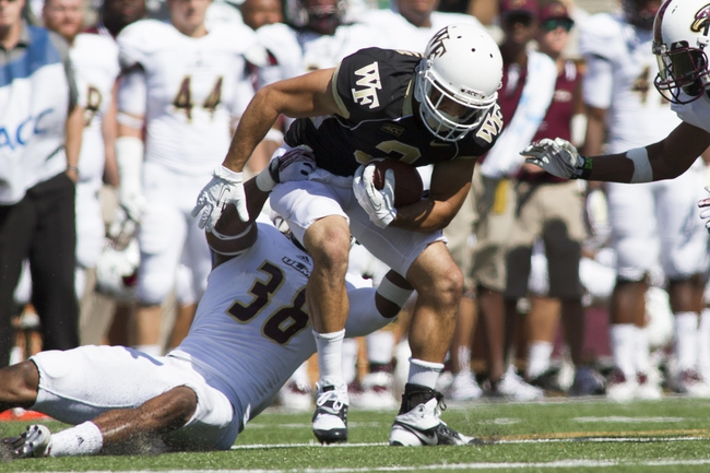 Sep 14, 2013; Winston-Salem, NC, USA; Wake Forest Demon Deacons wide receiver Michael Campanaro (3) gets tackled by Louisiana Monroe Warhawks safety Mitch Lane (38) during the fourth quarter at BB&T Field. Louisiana Monroe Warhawks defeated the Wake Forest Demon Deacons 21-19. Mandatory Credit: Jeremy Brevard-USA TODAY Sports