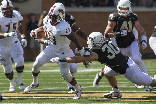 Sep 14, 2013; Winston-Salem, NC, USA; Louisiana Monroe Warhawks wide receiver Kenzee Jackson (23) runs through the tackle of Wake Forest Demon Deacons linebacker Hunter Williams (30) during the third quarter at BB&T Field. Louisiana Monroe Warhawks defeated the Wake Forest Demon Deacons 21-19. Mandatory Credit: Jeremy Brevard-USA TODAY Sports