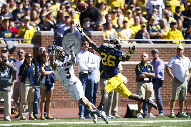 Sep 14, 2013; Ann Arbor, MI, USA; Akron Zips wide receiver L.T. Smith (3) makes a catch over Michigan Wolverines defensive back Jourdan Lewis (26) on the one yard line in the second half at Michigan Stadium. Michigan won 28-24. Mandatory Credit: Rick Osentoski-USA TODAY Sports
