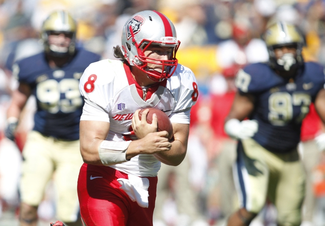 Sep 14, 2013; Pittsburgh, PA, USA; New Mexico Lobos quarterback Cole Gautsche (8) carries the ball on a twelve yard touchdown run against the Pittsburgh Panthers during the third quarter at Heinz Field. The Pittsburgh Panthers won 49-27. Mandatory Credit: Charles LeClaire-USA TODAY Sports