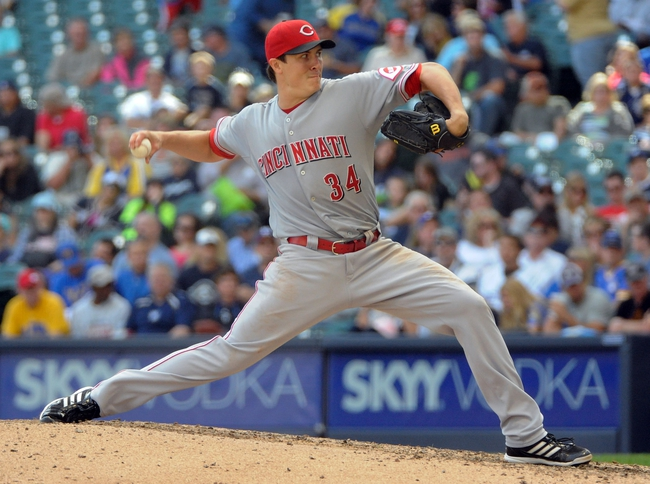 Sep 14, 2013; Milwaukee, WI, USA;  Cincinnati Reds pitcher Homer Bailey pitches in the sixth inning against the Milwaukee Brewers at Miller Park. Mandatory Credit: Benny Sieu-USA TODAY Sports