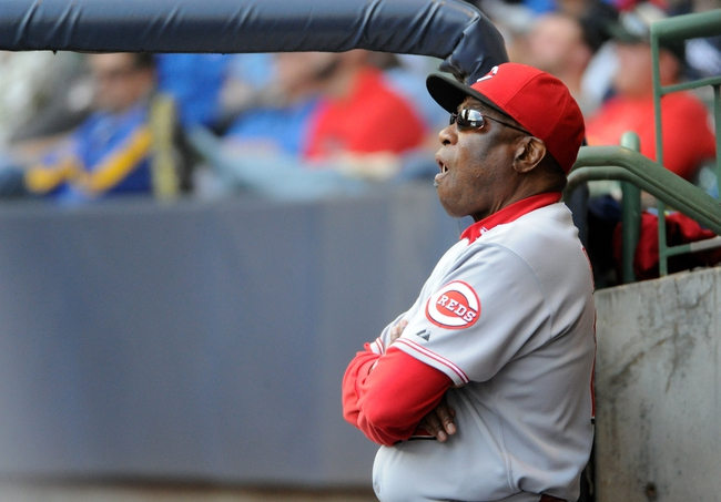 Sep 14, 2013; Milwaukee, WI, USA;  Cincinnati Reds manager Dusty Baker watches the game against the Milwaukee Brewers in the sixth inning at Miller Park. Mandatory Credit: Benny Sieu-USA TODAY Sports