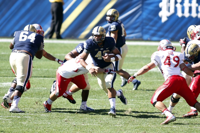 Sep 14, 2013; Pittsburgh, PA, USA; Pittsburgh Panthers running back James Conner (40) carries the ball up the middle against the New Mexico Lobos during the fourth quarter at Heinz Field. The Pittsburgh Panthers won 49-27. Mandatory Credit: Charles LeClaire-USA TODAY Sports