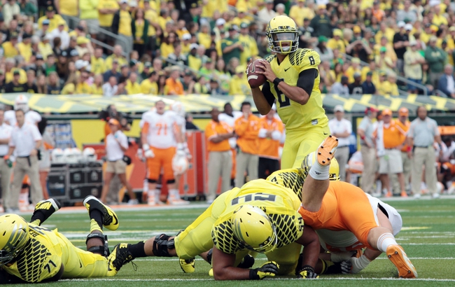 Sep 14, 2013; Eugene, OR, USA; Oregon Ducks quarterback Marcus Mariota (8) throws the ball in the first quarter against the Tennessee Volunteers at Autzen Stadium. Mandatory Credit: Scott Olmos-USA TODAY Sports