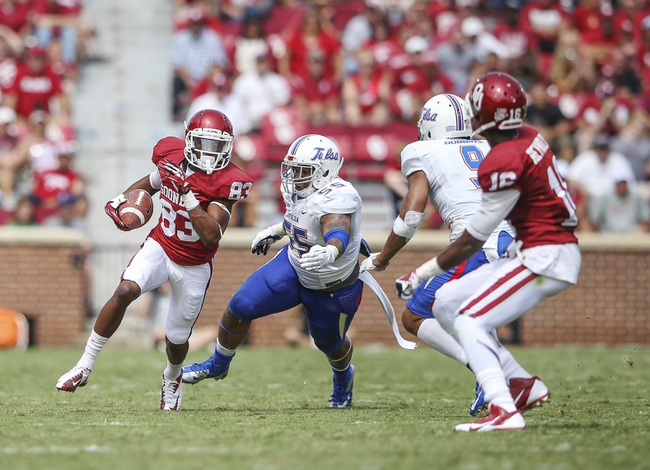Sep 14, 2013; Norman, OK, USA; Oklahoma Sooners wide receiver Austin Bennett (83) runs past Tulsa Golden Hurricane linebacker Shawn Jackson (55) during the game at Gaylord Family - Oklahoma Memorial Stadium. Mandatory Credit: Kevin Jairaj-USA TODAY Sports