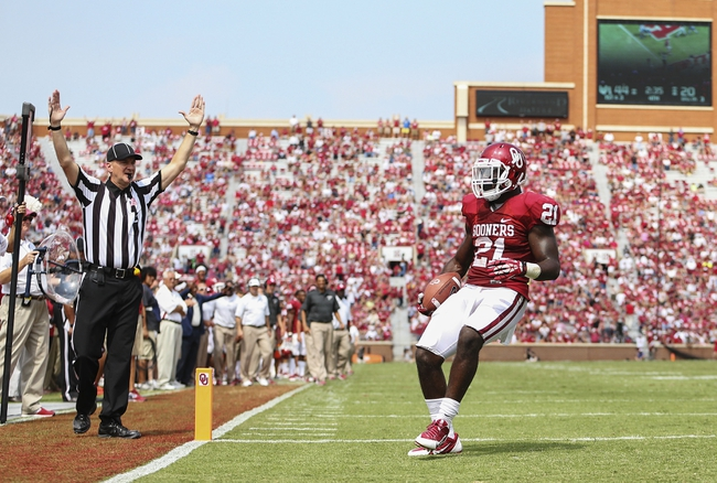 Sep 14, 2013; Norman, OK, USA; Oklahoma Sooners running back Keith Ford (21) scores a touchdown during the game against the Tulsa Golden Hurricane at Gaylord Family - Oklahoma Memorial Stadium. Mandatory Credit: Kevin Jairaj-USA TODAY Sports