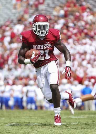 Sep 14, 2013; Norman, OK, USA; Oklahoma Sooners running back Keith Ford (21) runs during the game against the Tulsa Golden Hurricane at Gaylord Family - Oklahoma Memorial Stadium. Mandatory Credit: Kevin Jairaj-USA TODAY Sports
