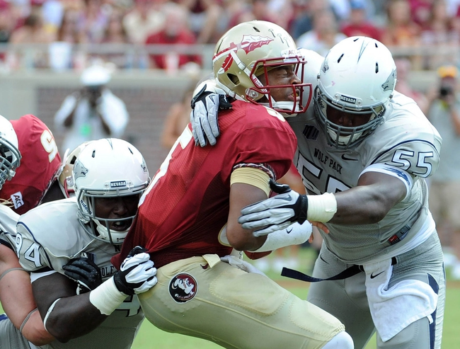 Sep 14, 2013; Tallahassee, FL, USA; Florida State Seminoles quarterback Jameis Winston (5) is sacked by Nevada Wolf Pack defensive lineman Rykeem Yates (55) during the first half of the game at Doak Campbell Stadium. Mandatory Credit: Melina Vastola-USA TODAY Sports