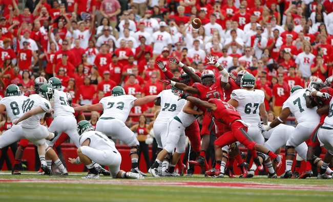 Sep 14, 2013; Piscataway, NJ, USA;  Rutgers Scarlet Knights try to block field goal attempt by Eastern Michigan Eagles kicker Dylan Mulder (38) during the second half at High Points Solutions Stadium. Rutgers Scarlet Knights defeat Eastern Michigan Eagles 28-10. Mandatory Credit: Jim O'Connor-USA TODAY Sports