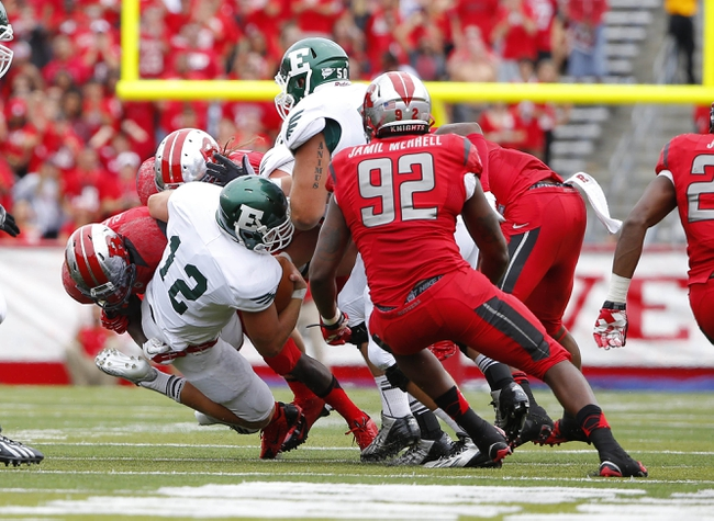 Sep 14, 2013; Piscataway, NJ, USA;  Eastern Michigan Eagles quarterback Tyler Benz (12) is sacked during the second half by Rutgers Scarlet Knights at High Points Solutions Stadium. Rutgers Scarlet Knights defeat Eastern Michigan Eagles 28-10. Mandatory Credit: Jim O'Connor-USA TODAY Sports