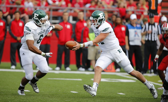Sep 14, 2013; Piscataway, NJ, USA;  Eastern Michigan Eagles quarterback Tyler Benz (12) hands off to running back Darius Jackson (6) during the second half against the Rutgers Scarlet Knights at High Points Solutions Stadium. Rutgers Scarlet Knights defeat Eastern Michigan Eagles 28-10. Mandatory Credit: Jim O'Connor-USA TODAY Sports