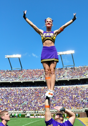 Sep 14, 2013; Greenville, NC, USA;  East Carolina Pirates cheerleader performs during the second half against the Virginia Tech Hokies at Dowdy-Ficklen Stadium.  Virginia Tech won 15-10. Mandatory Credit: Rob Kinnan-USA TODAY Sports