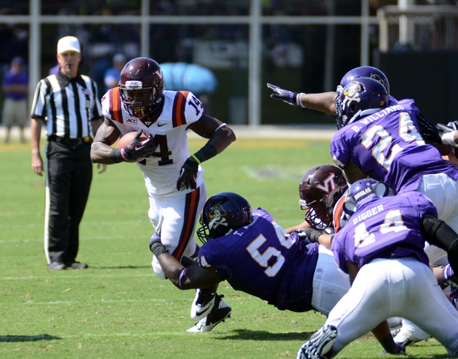 Sep 14, 2013; Greenville, NC, USA;  Virginia Tech Hokies running back Trey Edmunds (14) runs the ball during the second half as East Carolina Pirates nose tackle Terry Williams (54) attempts to tackle him at Dowdy-Ficklen Stadium.  Virginia Tech won 15-10. Mandatory Credit: Rob Kinnan-USA TODAY Sports