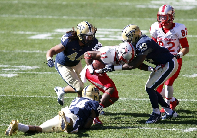 Sep 14, 2013; Pittsburgh, PA, USA; New Mexico Lobos wide receiver Ridge Jones (11) is brought down after a pass reception by Pittsburgh Panthers linebacker Shane Gordon (44) and defensive back Cullen Christian (24) and defensive back Terrish Webb (19) defend during the fourth quarter at Heinz Field. The Pittsburgh Panthers won 49-27. Mandatory Credit: Charles LeClaire-USA TODAY Sports